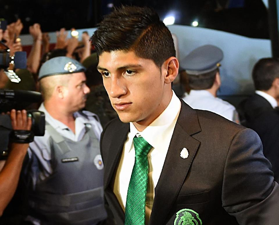 Mexican football star Alan Pulido was kidnapped on May 29 by four armed men as he returned from a party with his girlfriend in Tamaulipas (AFP Photo/Yuri Cortez)
