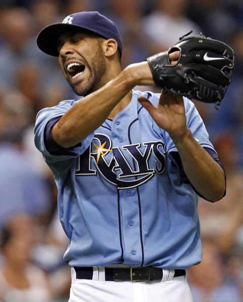 FILE - This Aug. 5, 2012 file photo shows Tampa Bay Rays' David Price reacting to a catch by right fielder Matt Joyce on a fly ball by Baltimore Orioles' Taylor Teagarden during the second inning of a baseball game in St. Petersburg, Fla. Price and 2011 winner Justin Verlander are among the finalists for this year's AL Cy Young Award, Wednesday, Nov. 14, 2012. (AP Photo/Mike Carlson, FIle)