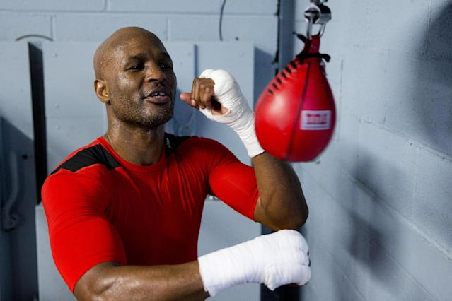 In this April 10, 2014 photo, IBF light heavyweight boxing champion Bernard Hopkins works a speed bag during a media workout in Philadelphia. Hopkins will attempt to become the oldest fighter in boxing history to unify world titles when he opposes WBA champion Beibut Shumenov April 19th at the DC Armory. (AP Photo/Matt Rourke)