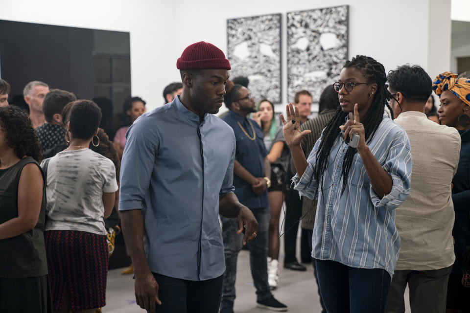 Yahya Abdul-Mateen II and director Nia DaCosta on the set of Candyman. - Credit: Parrish Lewis/Universal Pictures