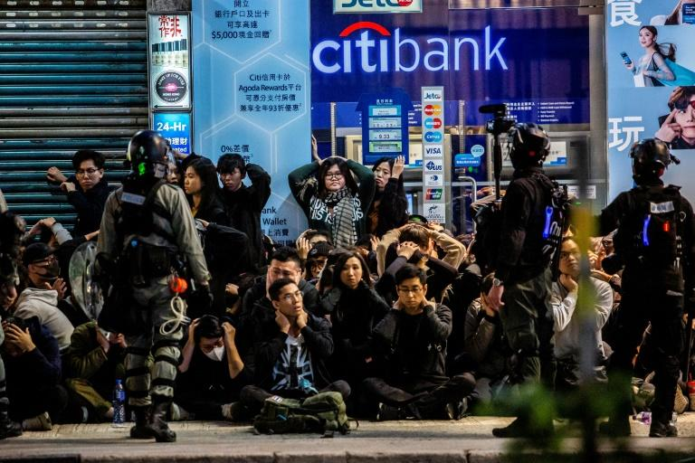 Police rounded up and detained scores of protesters as darkness fell