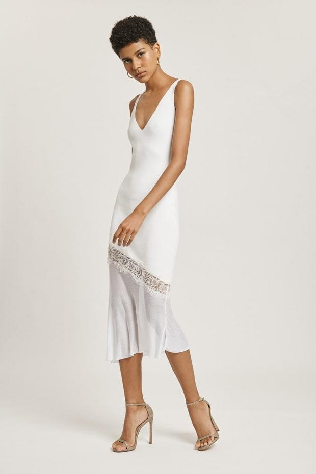 "<p>Cushnie White V Neck Dress, $615, <a href=""https://www.cushnie.com/collections/dresses/products/white-v-neck-knit-dress-with-lace-detail"" rel=""nofollow noopener"" target=""_blank"" data-ylk=""slk:available here"" class=""link rapid-noclick-resp"">available here</a>.</p>"