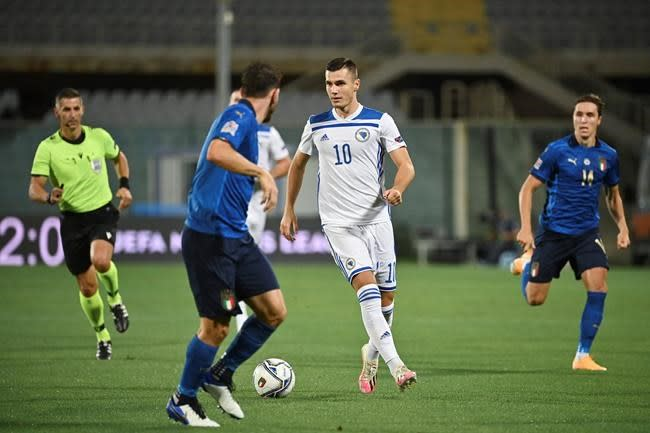 Italy's winning streak ends at 11 after draw with Bosnia
