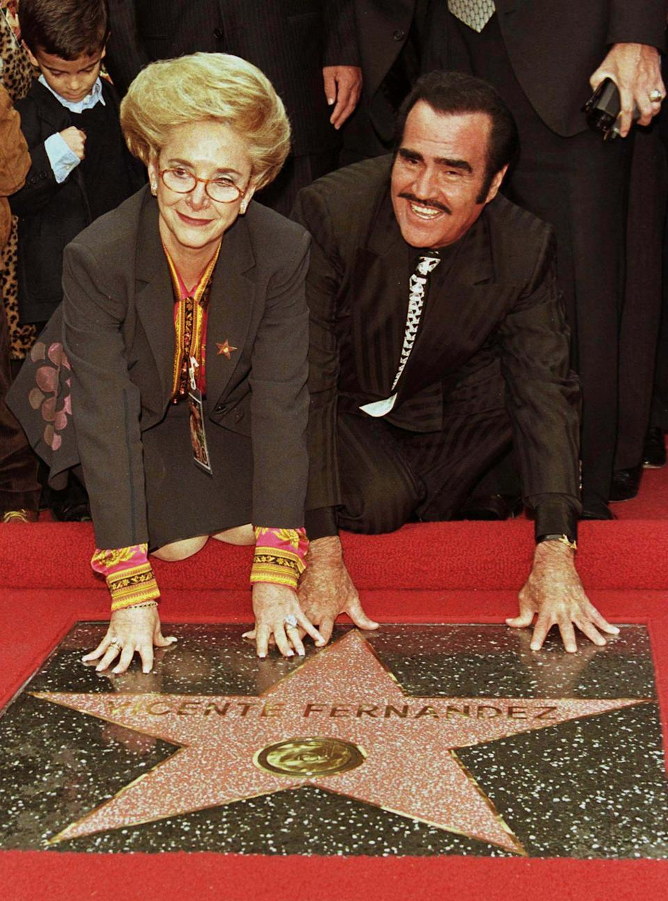Mexican mariachi singer Vicente Fernandez poses with his wife,Cuquita, on his star on the Hollywood Walk of Fame during ceremonies to honor him November 11. Fernandez is internationally recognized as the king of Mexican Ranchera music and has sold over 60 million records worldwide.  RMP/SV/AA