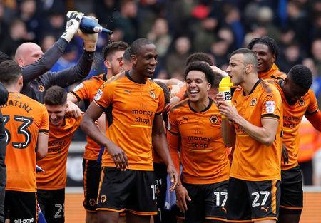 Soccer Football - Championship - Wolverhampton Wanderers vs Birmingham City - Molineux Stadium, Wolverhampton, Britain - April 15, 2018 Wolverhampton Wanderers' Willy Boly and team mates celebrate promotion after the match Action Images via Reuters/Andrew Couldridge