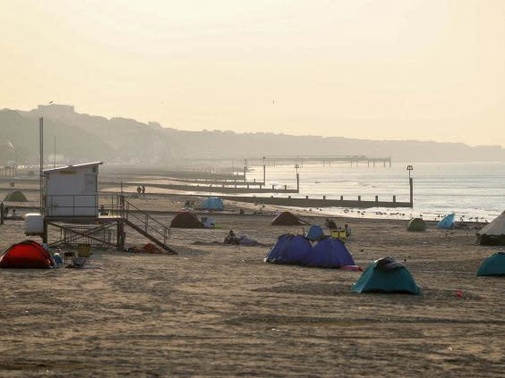 Tents pitched up on Bournemouth beach in Dorset as the sun rises (PA)