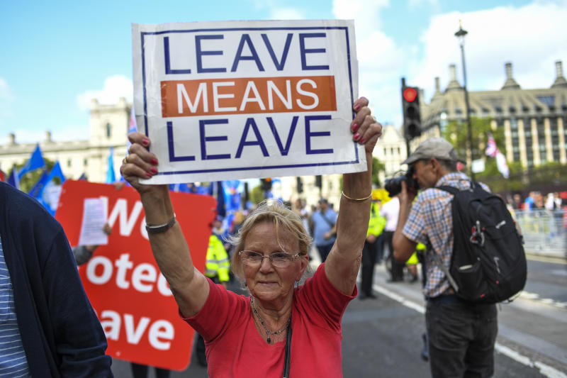 Pro Brexit demonstrators gather and march at Parliament Square, in London, Tuesday, Sept. 3, 2019. Lawmakers returned from their summer recess Tuesday for a pivotal day in British politics as they challenged Prime Minister Boris Johnson's insistence that the U.K. leave the European Union on Oct. 31, even without a withdrawal agreement to cushion the economic blow. (AP Photo/Alberto Pezzali)
