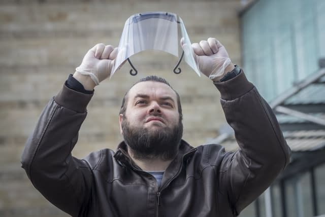 Sid Lovatt with his 3D-printed protective mask that he has been supplying to frontline workers