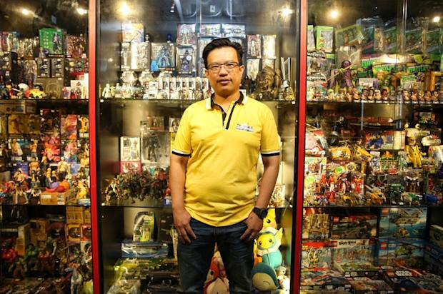 Oska Chin poses with some of the toys he sells at his shop in Sungei Wang Plaza.