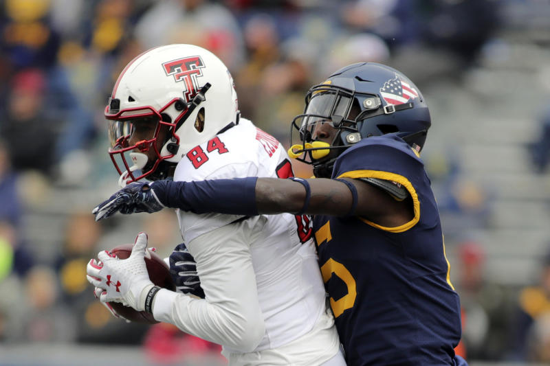Texas Tech's Erik Ezukanma (84) catches a ball as West Virginia's Kerry Martin Jr. (15) defends during the third quarter of their NCAA college football game in Morgantown, W.Va., Saturday, Nov. 9, 2019. (AP Photo/Chris Jackson)