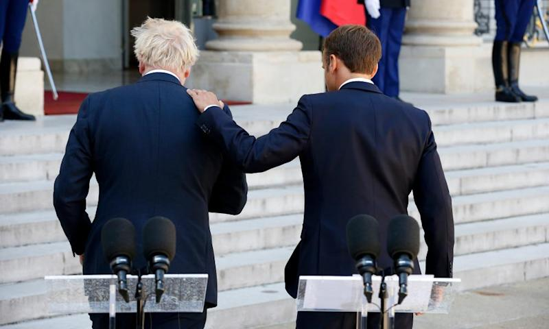 Macron pats Johnson on the shoulder