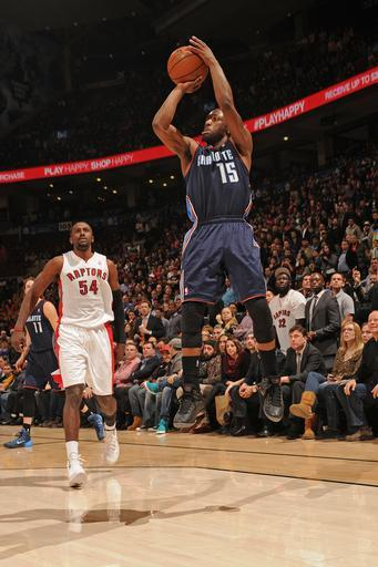 TORONTO, CANADA - December 18: Kemba Walker #15 of the Charlotte Bobcats hits a buzzer beater to beat the Toronto Raptors on December 18, 2013 at the Air Canada Centre in Toronto, Ontario, Canada. (Photo by Ron Turenne/NBAE via Getty Images)