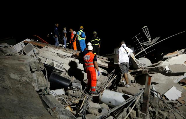 <p>Rescue workers check a collapsed house after an earthquake hits the island of Ischia, off the coast of Naples, Italy, Aug. 22, 2017. (Photo: Ciro De Luca/Reuters) </p>