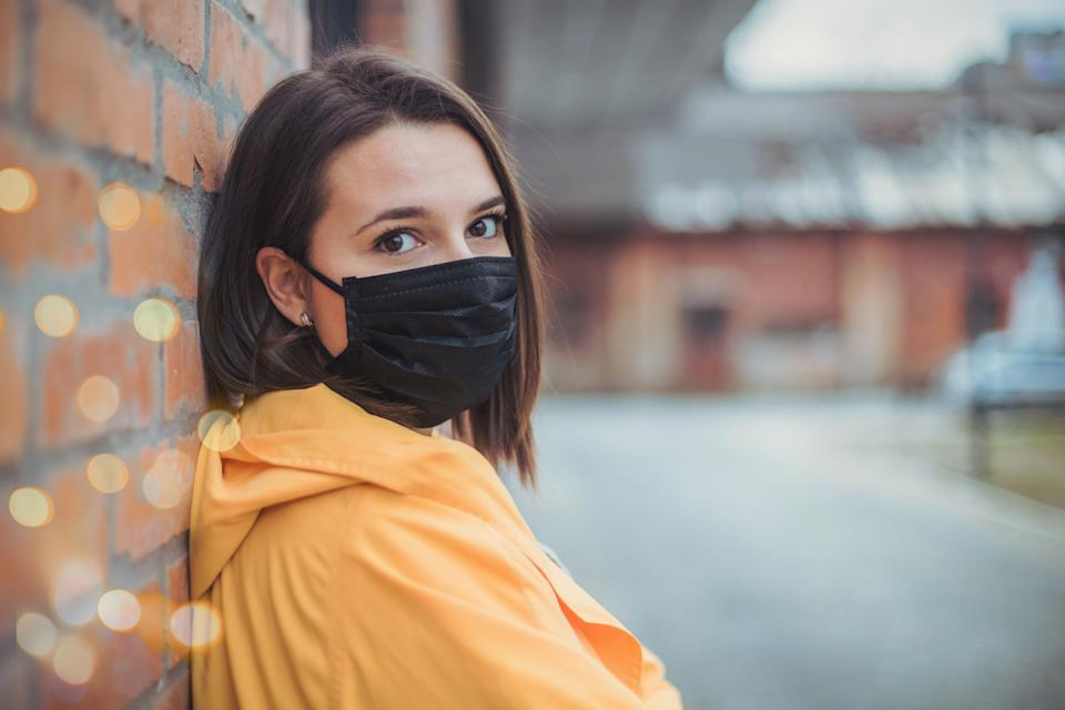 Portrait of young woman wearing 2.5PM face mask