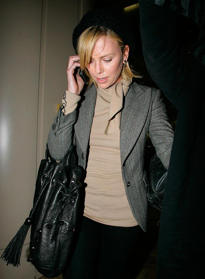 """Charlize Theron was greeted by the paparazzi after landing at LAX Wednesday. The Academy Award-winning actress was recently named the recipient of the 2008 Hasty Pudding Award for her """"lasting and impressive contribution to the world of entertainment."""" Westley Hargrave/<a href=""""http://www.splashnewsonline.com/"""" target=""""new"""">Splash News</a> - January 23, 2008"""