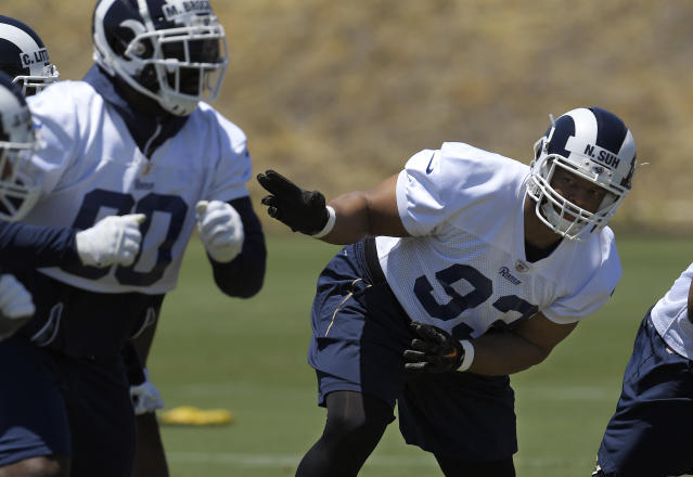Los Angeles Rams defensive tackle Michael Brockers, left, and defensive tackle Ndamukong Suh run a play during practice at the NFL football team's minicamp Tuesday, June 12, 2018, in Thousand Oaks, Calif. (AP Photo/Mark J. Terrill)