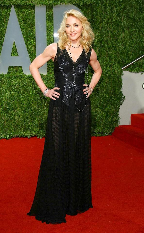 """The best dressed woman at Vanity Fair's post-Oscars fete was undoubtedly Madonna, who wowed the crowd in a daring Christian Dior dress which featured a sheer skirt. Kristian Dowling/<a href=""""http://www.wireimage.com"""" target=""""new"""">WireImage.com</a> - February 22, 2009"""
