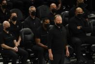 Milwaukee Bucks head coach Mike Budenholzer watches during the first half of an NBA basketball game against the Toronto Raptors Tuesday, Feb. 16, 2021, in Milwaukee. (AP Photo/Morry Gash)