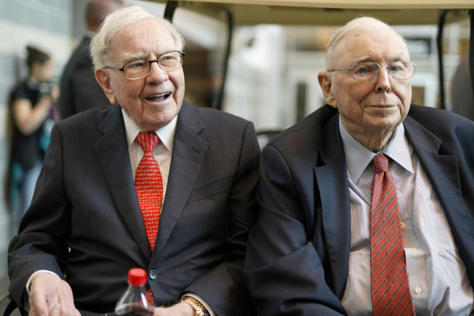 In this May 3, 2019 file photo, Berkshire Hathaway Chairman and CEO Warren Buffett, left, and Vice Chairman Charlie Munger, briefly chat with reporters before Berkshire Hathaway's annual shareholders meeting. (AP Photo/Nati Harnik)