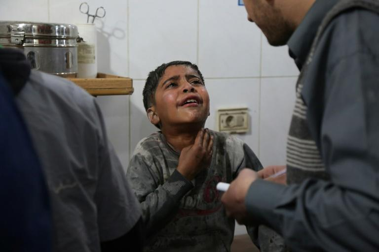 A Syrian boy wounded in reported regime air strikes on the rebel-held enclave of Eastern Ghouta receives treatment at a makeshift hospital in Kafar Batna on March 7, 2018