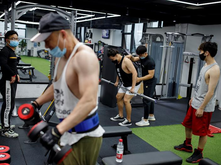 People exercise at Mi Fitness after the reopening of some of Beijing's gyms in Beijing, China, May 8, 2020