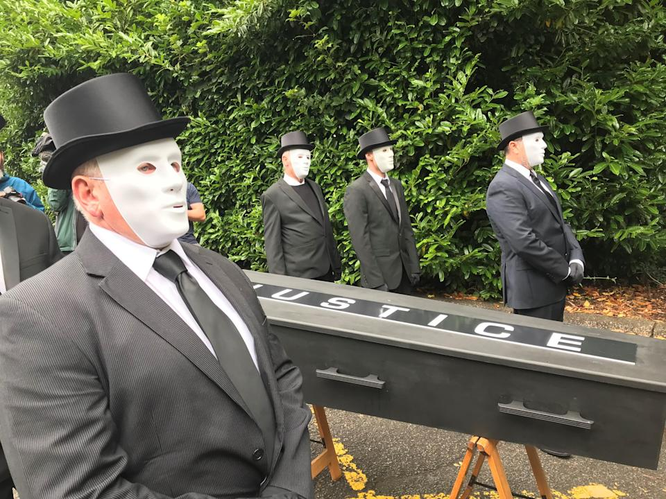 Protesters take the coffin to the gates of Stormont House (Jonathan McCambridge/PA)