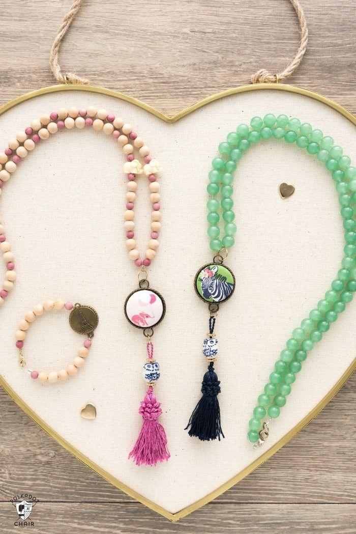 """<p>She'll never want to take these cute necklaces off — not only because they go with any outfit, but because you made them with your own two hands.</p><p><em><strong>Get the tutorial from <a href=""""https://www.polkadotchair.com/diy-beaded-tassel-necklace-tutorial/"""" rel=""""nofollow noopener"""" target=""""_blank"""" data-ylk=""""slk:Polkadot Chair"""" class=""""link rapid-noclick-resp"""">Polkadot Chair</a>.</strong></em> </p><p><strong><a class=""""link rapid-noclick-resp"""" href=""""https://www.amazon.com/400pcs-20mm-Natural-Wood-Beads/dp/B08HQ6S9Q9/ref=sr_1_2?dchild=1&keywords=WOOD+BEADS&qid=1605822386&sr=8-2&tag=syn-yahoo-20&ascsubtag=%5Bartid%7C10063.g.34832092%5Bsrc%7Cyahoo-us"""" rel=""""nofollow noopener"""" target=""""_blank"""" data-ylk=""""slk:SHOP BEADS"""">SHOP BEADS</a></strong></p>"""