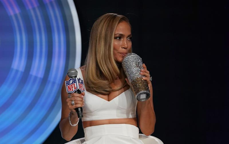 Pepsi Super Bowl LIV Halftime Show Performers Jennifer Lopez holds a blinged up water bottle as she and Shakira (out of frame) hold a press conference at the Hilton Miami Downtown January 30, 2020 in Miami. - The two will peform the halftime show during Super Bowl LIV between the San Francisco 49ers and the Kansas City Chiefs at the Hard Rock Stadium, Miami Gardens, FL on February 2, 2020. (Photo by TIMOTHY A. CLARY / AFP) (Photo by TIMOTHY A. CLARY/AFP via Getty Images)