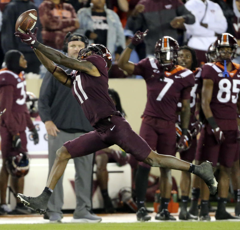 Virginia Tech wide receiver Tre Turner (11) attempts to catch a pass during the second half of an NCAA college football game against Notre Dame in Blacksburg, Va., Saturday, Oct. 9, 2021. (AP Photo/Matt Gentry)