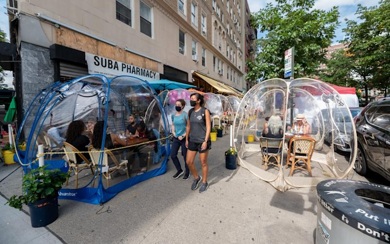 New York, USA: Diners eat in social distancing bubble tents at the Cafe Du Soleil restaurant on the Upper West Side - Getty Images