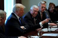 U.S. President Donald Trump, flanked by U.S. Representative Steny Hoyer (D-MD), House Majority Leader Kevin McCarthy (R-CA) and Senator James Lankford (R-OK), holds a bipartisan meeting with legislators on immigration reform at the White House in Washington, U.S. January 9, 2018. REUTERS/Jonathan Ernst