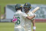 South Africa's Faf du Plessis reaches 150 and is embraced by teammate Keshav Maharaj, on day three of the first cricket test match between South Africa and Sri Lanka at Super Sport Park Stadium in Pretoria, South Africa, Monday, Dec. 28 2020. (AP Photo/Catherine Kotze)