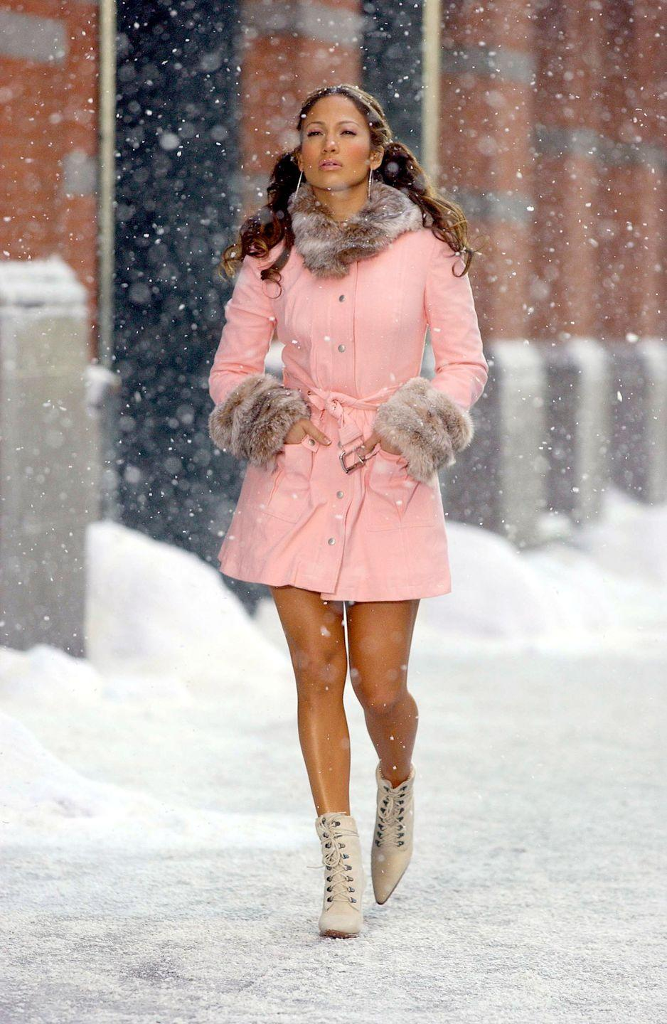 <p>On location in a 3/4 length baby pink coat for the music video filmed in a snowy New York City.</p>