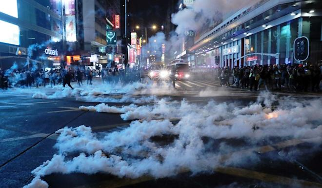 Police fire tear gas to disperse protesters in Mong Kok. Photo: Sam Tsang