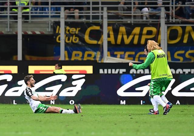 On target: Sassuolo forward Domenico Berardi celebrates after scoring against Inter Milan (AFP Photo/MIGUEL MEDINA)