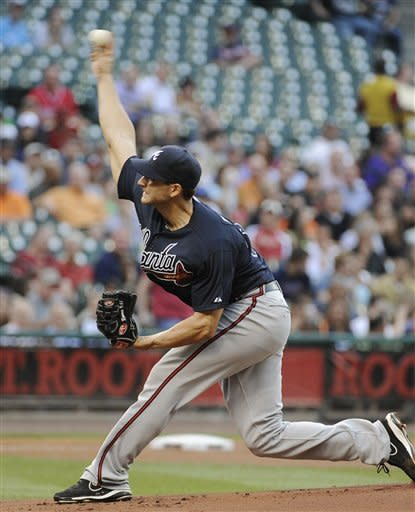 Atlanta Braves' Brandon Beachy delivers a pitch in the first inning against the Houston Astros in a baseball game Monday, April 9, 2012, in Houston. (AP Photo/Pat Sullivan)