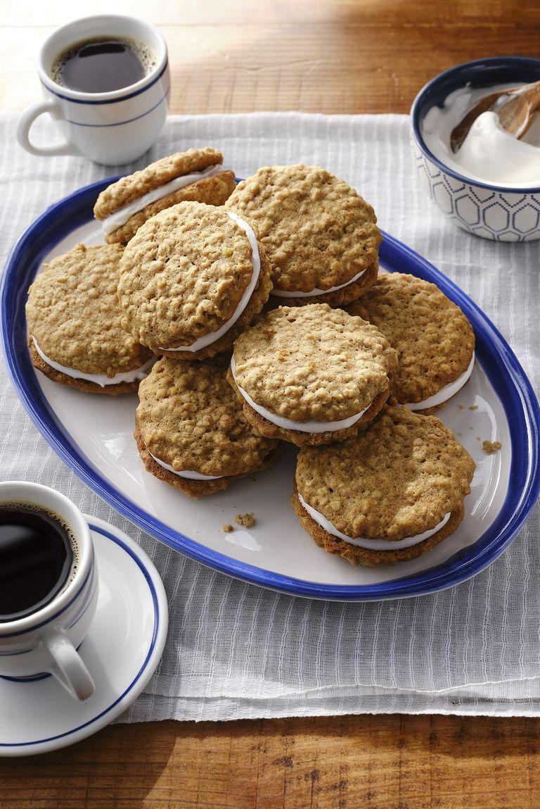 """<p>These irresistible oatmeal cream pies will be the best companion to a steaming cup of coffee.</p><p><strong><a href=""""https://www.countryliving.com/food-drinks/a30419054/oatmeal-cream-pies-recipe/"""" rel=""""nofollow noopener"""" target=""""_blank"""" data-ylk=""""slk:Get the recipe"""" class=""""link rapid-noclick-resp"""">Get the recipe</a>.</strong></p><p><a class=""""link rapid-noclick-resp"""" href=""""https://www.amazon.com/Home-table-folding-breakfast-Bamboo/dp/B00PHS97EU/?tag=syn-yahoo-20&ascsubtag=%5Bartid%7C10050.g.1681%5Bsrc%7Cyahoo-us"""" rel=""""nofollow noopener"""" target=""""_blank"""" data-ylk=""""slk:SHOP BREAKFAST TRAYS"""">SHOP BREAKFAST TRAYS</a></p>"""