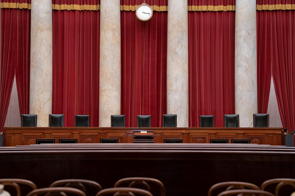 Some Democratic lawmakers have proposed adding four chairs to the nine justices' seats on the Supreme Court bench.