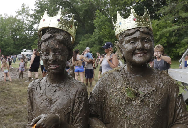 <p>Mackenna Kofahl, 10, left, and Brian Wilson, 10, poses after being named 2017 Queen and King of the annual Mud Day at the Nankin Mills Park, July 11, 2017, in Westland, Mich. (Photo: Carlos Osorio/AP) </p>