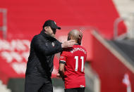 Southampton's manager Ralph Hasenhuettl, left, celebrates with Southampton's Nathan Redmond at the end of the English Premier League soccer match between Southampton and Burnley at St. Mary's Stadium in Southampton, England, Sunday, April 4, 2021. (Andrew Boyers/Pool via AP)