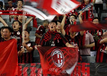 FILE PHOTO: Chinese fans of AC Milan sing before their team's International Champions Cup friendly match against Inter Milan in Shenzhen