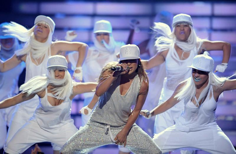 "Jennifer Lopez, center, performs onstage at the ""American Idol"" finale on Wednesday, May 23, 2012 in Los Angeles. (Photo by John Shearer/Invision/AP)"