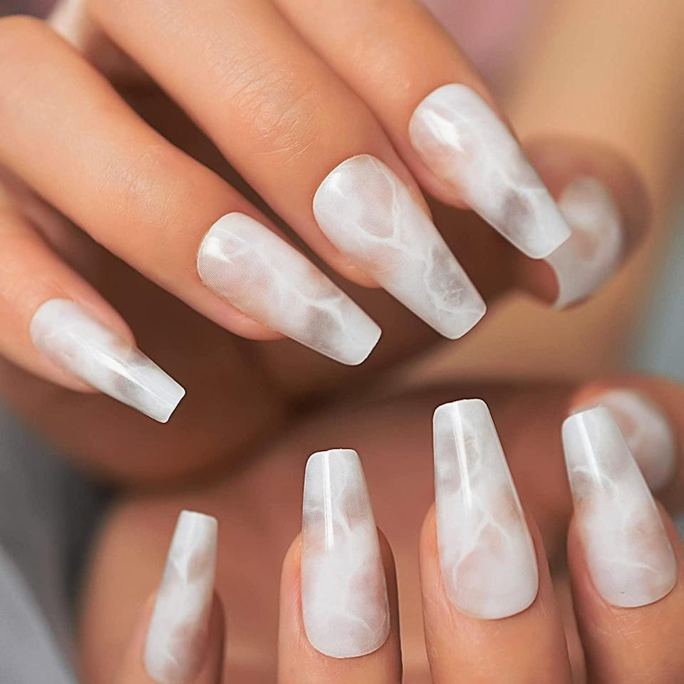 <p>How stylish and mesmerizing are these <span> Coolnail Glossy White Marble Press On Nails</span> ($6). The coffin-shaped nail is such a unique design. It looks like marble, clouds, or even smoke. </p>