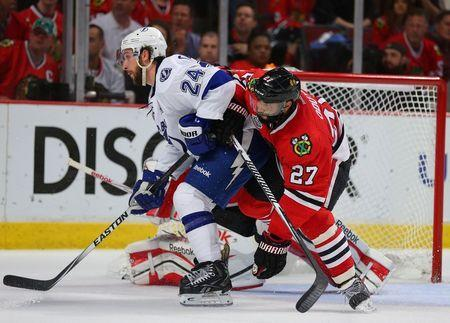 Chicago Blackhawks defenseman Johnny Oduya (27) defends the goal against Tampa Bay Lightning right wing Ryan Callahan (24) during the third period of game six of the 2015 Stanley Cup Final at United Center on Jun 15, 2015. Dennis Wierzbicki-USA TODAY Sports