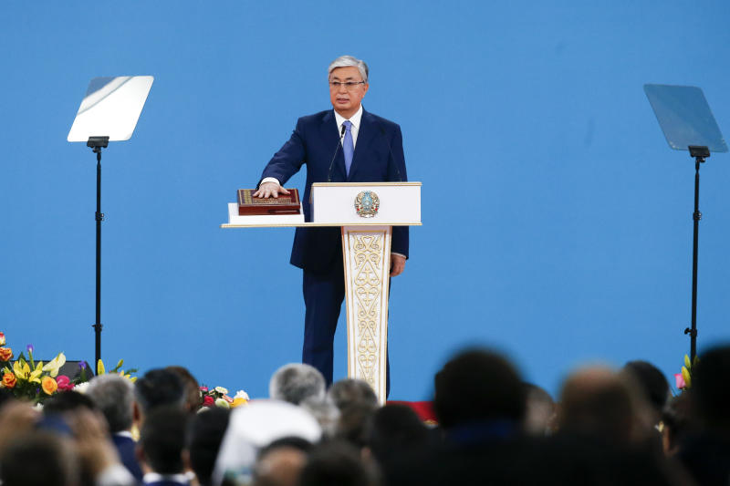 Kazakhstan's President-elect Kassym-Jomart Tokayev places his hand on the Quran as he takes the oath of office during his inauguration ceremony in Nur-Sultan, the capital city of Kazakhstan, Wednesday, June 12, 2019. Tokayev, an ally of Kazakhstan's former president was named the winner of the presidential election on Monday in a vote marred by a police crackdown on protesters who criticized the result as an orchestrated handover of power. (AP Photo/Alexei Filippov)