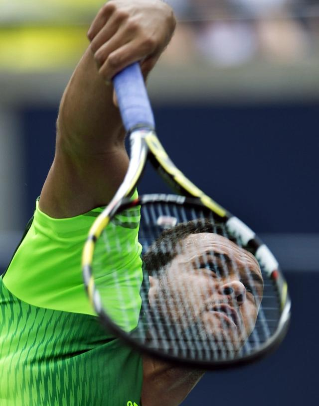 Jo-Wilfried Tsonga of France serves during his win over Andy Murray of Great Britain at the Rogers Cup tennis tournament, Friday, Aug. 8, 2014 in Toronto. (AP Photo/The Canadian Press, Frank Gunn)