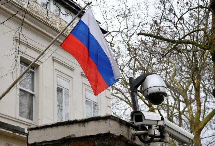 FILE PHOTO: A flag flies outside the consular section of Russia's Embassy in London