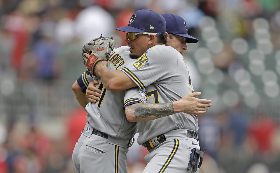 Milwaukee Brewers' Willy Adames, right, celebrates with pitcher Josh Hader at the end of a baseball game against the Atlanta Braves, Sunday, Aug. 1, 2021, in Atlanta. (AP Photo/Ben Margot)