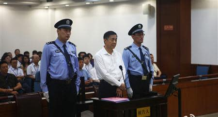 Disgraced Chinese politician Bo Xilai stands trial inside the court in Jinan, Shandong province, August 22, 2013, in this file photo released by Jinan Intermediate People's Court. REUTERS/Jinan Intermediate People's Court/Handout via Reuters/Files