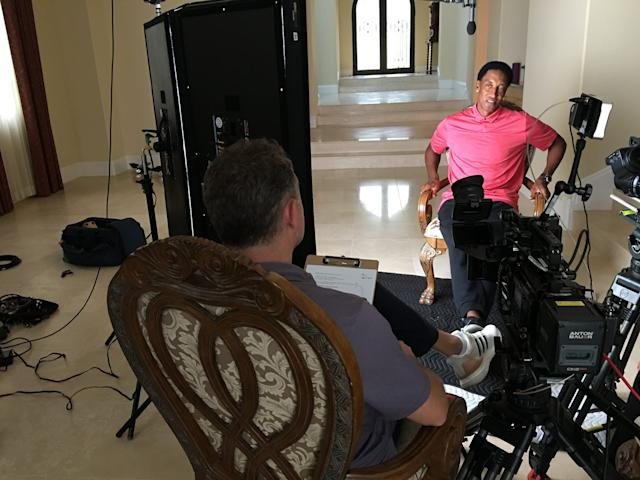 Scottie Pippen being interviewed in his empty house.